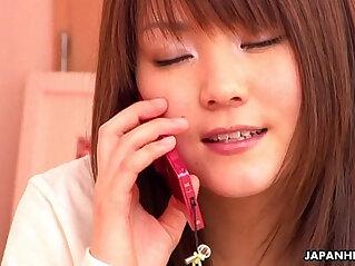 Japanese teen girl having phone sex